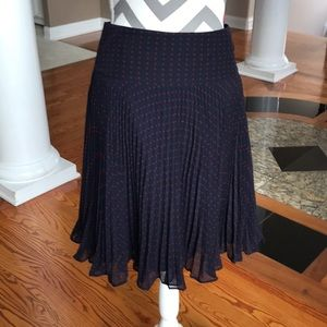 Red polka dot and navy pleated skirt